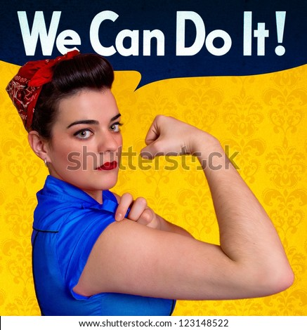 Beautiful young woman posing as working girl and representing the ideals of the original poster of Rosie the Riveter, year 1943 - stock photo