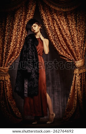 Beautiful young woman posing in fur. Luxury. Vintage style. Beauty, fashion. Full length portrait. - stock photo