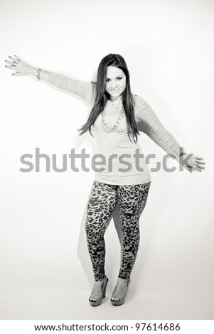 Beautiful young woman posing in studio with white background.