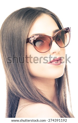 Beautiful young woman posing with sunglasses, isolated on white - stock photo