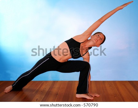 Beautiful young woman practicing yoga.