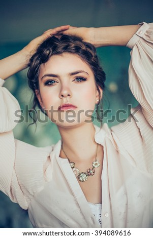 Beautiful young woman. Professional make-up and hairstyle. Perfect skin. Fashion photo.   - stock photo