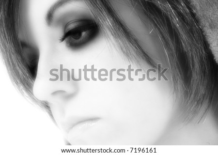 Beautiful young woman profile portrait in black and white.
