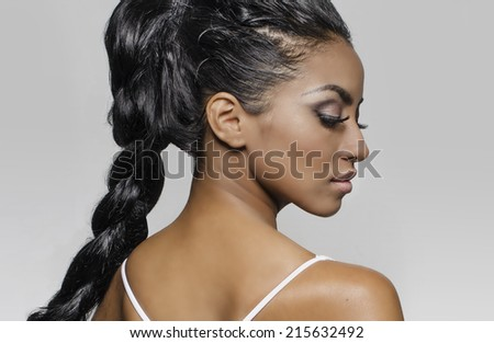 Beautiful young woman - profile viewpoint - braided long hair - stock photo
