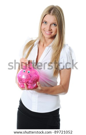 beautiful young woman putting coin into piggy bank. Isolated on white background