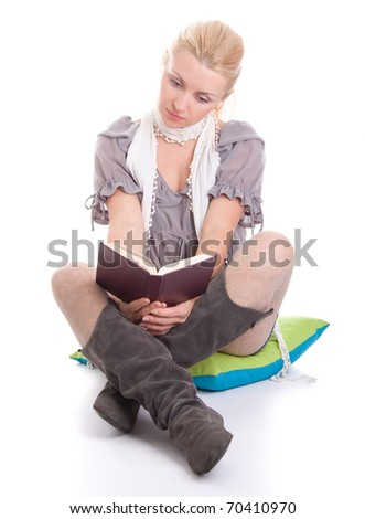 Beautiful young woman reading book, isolated on white background - stock photo