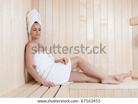 beautiful young woman relaxing in finnish sauna - stock photo