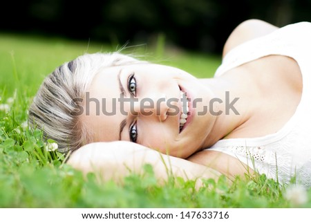 Beautiful young woman relaxing in the nature - stock photo