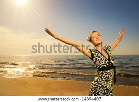 Beautiful young woman relaxing near the ocean