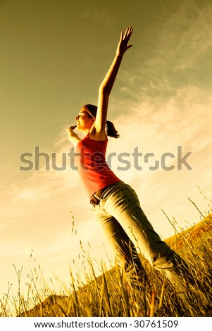 Beautiful young woman relaxing on the field - stock photo