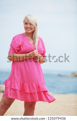 Beautiful young woman resting at the beach - stock photo