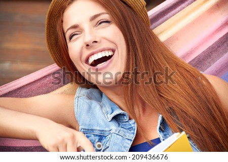 beautiful young woman resting in a hammock - stock photo