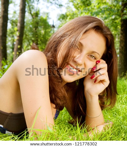 Beautiful Young Woman resting in the park - stock photo