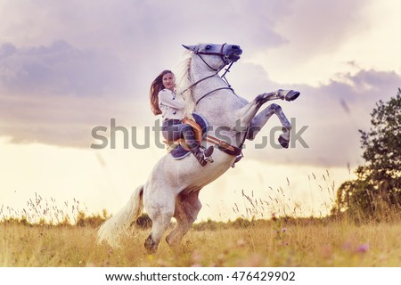 Horse Standing On Hind Legs With Rider