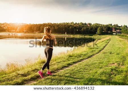 Beautiful young woman run in nature