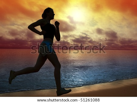 Beautiful young woman running on a beach at sunset - stock photo