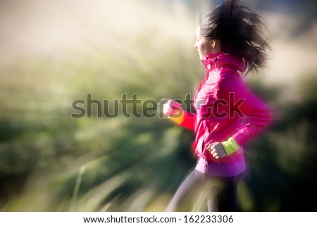 Beautiful Young woman running outdoors  - stock photo