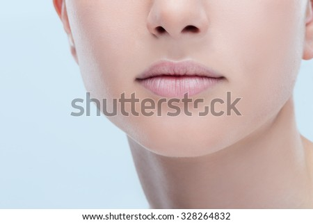 Beautiful young woman's full lips close-up, perfect skincare concept - stock photo