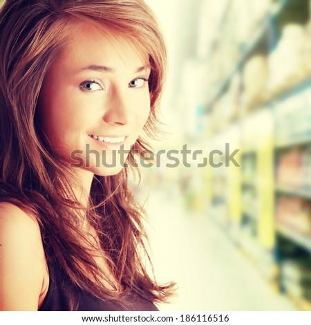 Beautiful young woman shopping - stock photo