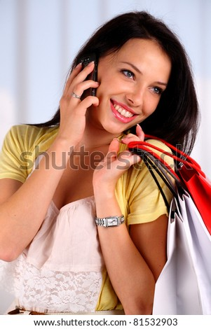 Beautiful young woman shopping - stock photo