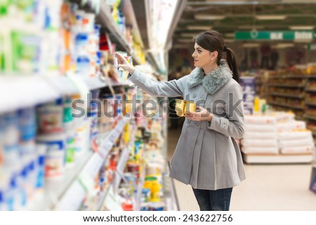 Beautiful Young Woman Shopping For Fruits And Vegetables In Produce Department Of A Grocery Store - Supermarket - Shallow Deep Of Field - stock photo