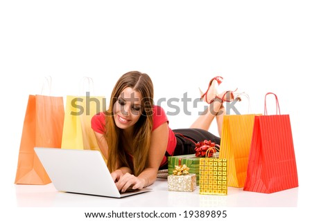 Beautiful young woman shopping over internet. - stock photo