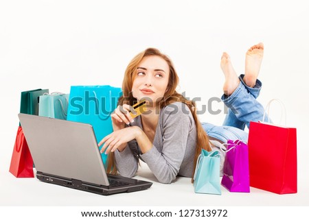 Beautiful young woman shopping over internet, online, isolated - stock photo