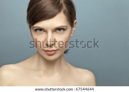Beautiful young woman shot in studio no makeup. Natural beauty - stock photo