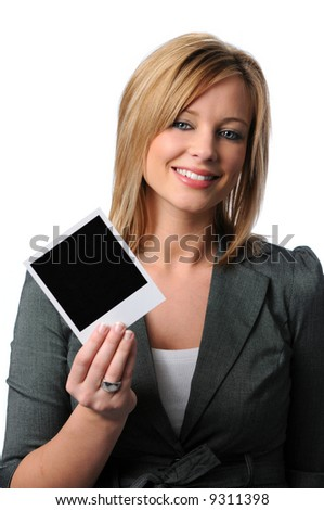 Beautiful young woman showing a blank instant photograph