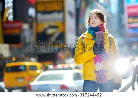Beautiful young woman sightseeing at Times Square, New York - stock photo