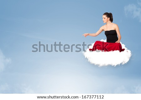 Beautiful young woman sitting on cloud with copy space - stock photo