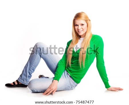 beautiful  young  woman sitting on the floor against white background - stock photo
