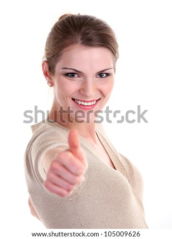 Beautiful young woman smiling brightly and showing thumb up sign