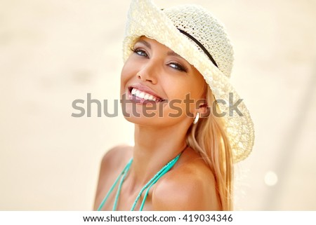 Beautiful young woman smiling - close up - stock photo