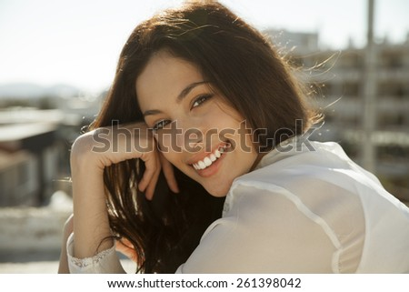 Beautiful young woman smiling. Natural young beauty. horizontal shot. outdoors - stock photo