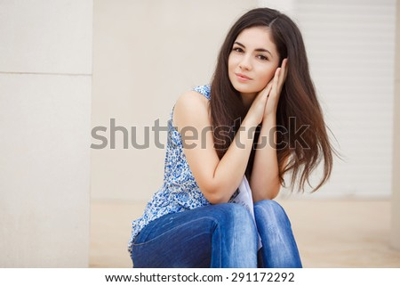 Beautiful young woman smiling outdoors portrait. Happy cheerful girl in summer, pretty female smiling. Young girl outdoors portrait. Beautiful brunette woman outdoor. Instagram style filters - stock photo