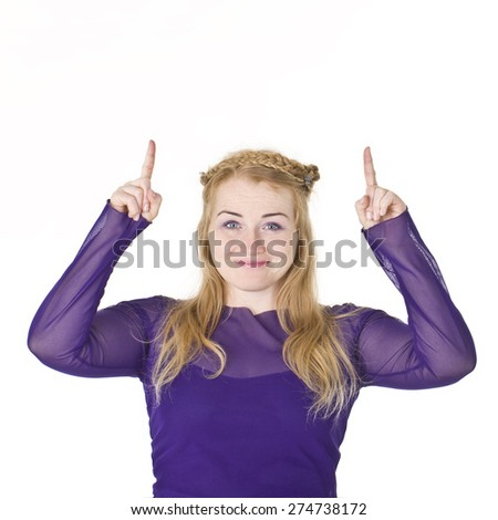 Beautiful young woman smiling portrait in purple showing product. - stock photo