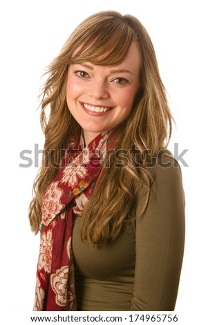 Beautiful Young Woman Smiling - This is a portrait of a beautiful young woman smiling. Shot on a white background with a shallow depth of field. - stock photo