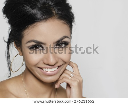 Beautiful young woman smiling wearing engagement ring - stock photo