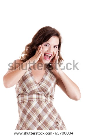 Beautiful young woman smilling with hands on face, isolated on white - stock photo