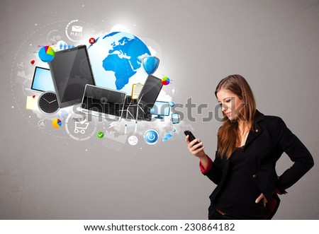 beautiful young woman standing and browsing on her phone - stock photo