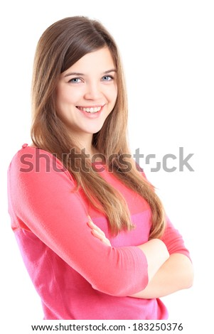 Beautiful young woman standing with arms crossed over a white background