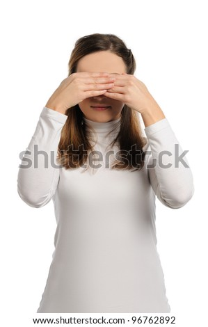Beautiful young woman stands with nothing see pose. One of wise monkey pose - stock photo