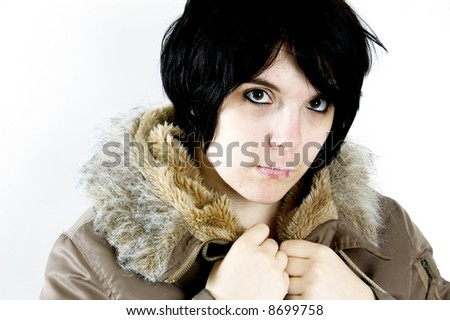 beautiful young woman staring at you little bit annoyed - stock photo