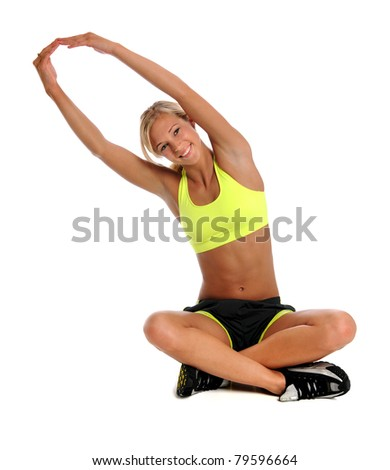 Beautiful young woman stretching isolated over white background