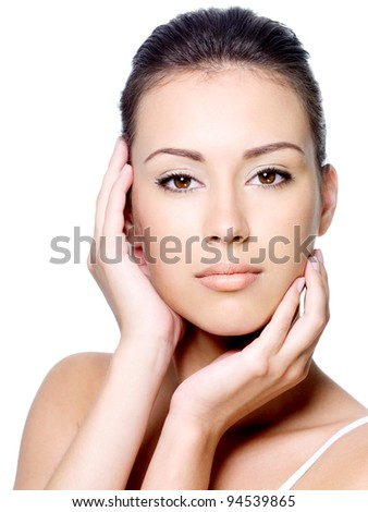 Beautiful young woman stroking her clean healthy face - isolated on white - stock photo