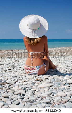 beautiful young woman sunbathing on the beach