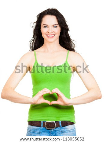 Beautiful young woman symboling a love heart with hands. in front of her tummy. Isolated over white.