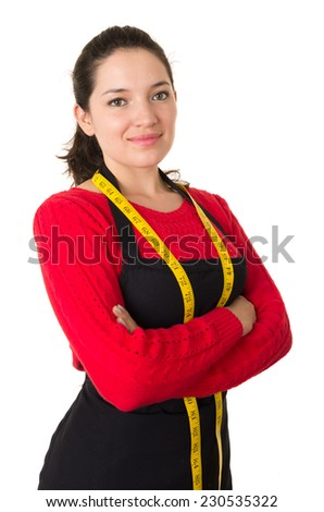 beautiful young woman tailor seamstress designer stylist holding measuring tape crossing arms isolated on white - stock photo