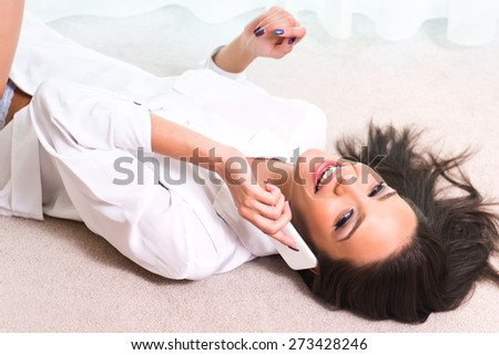 Beautiful young woman talking on the phone - stock photo